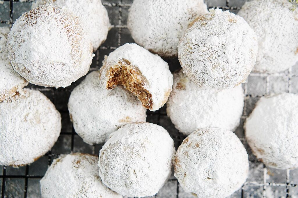 Baked Mexican Wedding Cookies on a cooling rack.