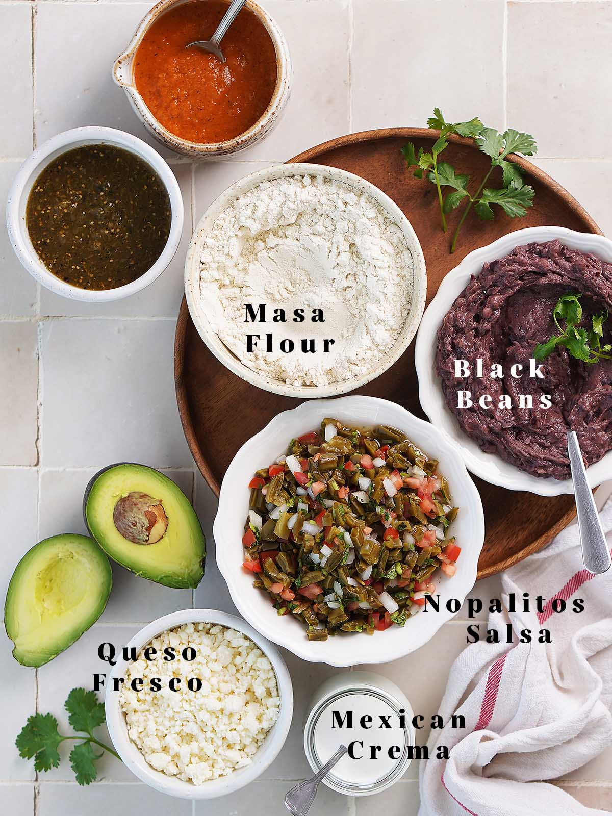 All of the ingredients in small white bowls.
